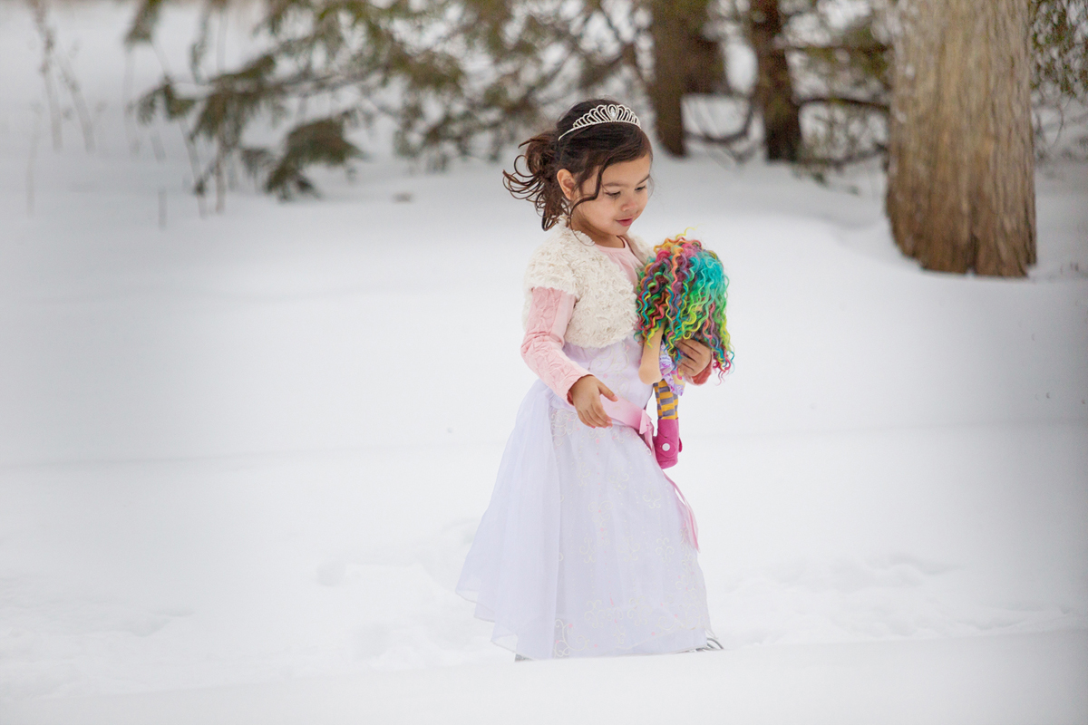 Playing with dolls in the snow